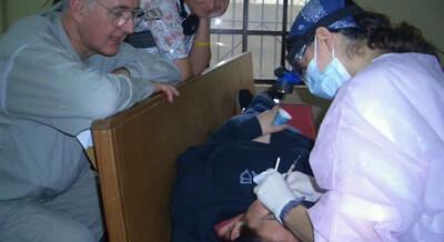 Dr. Davis giving assistance